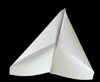 Paper Airplane. A white paper airplane aloft, flying through the darkness. A fun, simple homemade child's toy royalty free stock photography