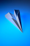 Paper Airplane. On blue background Royalty Free Stock Image