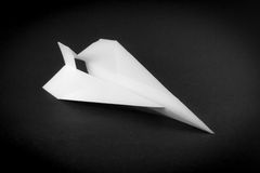 Paper Airplane on Black Stock Photo