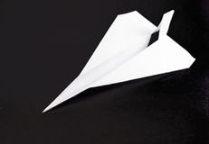 Paper Airplane on Black Royalty Free Stock Photo
