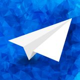 Paper airplane. On a blue abstract geometric background Royalty Free Stock Photo