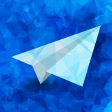 Paper airplane on a blue geometric background. Paper airplane on a blue abstract geometric background Royalty Free Stock Photos