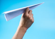 Paper airplane and blue sky. Stock Photo