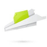 Paper airplane carrying the message Royalty Free Stock Photos