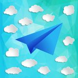 Paper airplane with clouds on the triangular background. Paper airplane with clouds on the abstract triangular background Royalty Free Stock Image
