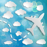 Paper airplane with clouds on a blue air background.  Blue sky t Royalty Free Stock Photo