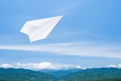 Paper airplane flying upon the mountain Royalty Free Stock Photo