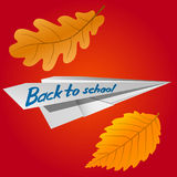 Paper airplane with the inscription Back to School. Falling autumn leaves. The celebration on 1 September. Vector Image. Paper airplane with the inscription Royalty Free Stock Photos