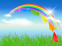 Paper airplane and rainbow Royalty Free Stock Photography