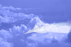 Paper Airplane in Sky with Clouds Stock Photos