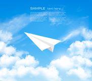Paper airplane in the sky with clouds. Stock Photos