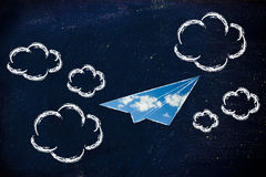 Paper airplane with sky fill and clouds. Paper airplane illustration with sky fill, symbol of freedom and imagination Royalty Free Stock Images