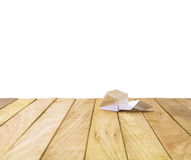 Paper airplane on a wooden platform. Stock Image
