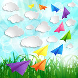 Paper airplanes with clouds on on a Natural green abstract Backg. Round stock illustration