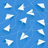 Paper airplanes. With dashed lines.  with dashed lines on a blue background.  with dashed lines in a flat style. Vector illustration Eps10 file royalty free illustration