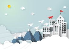 Paper airplane teamwork flying to red flag on top. Paper airplanes flying to red flag on the top of buildings,mountains and clouds.Paper art style of start up Stock Image