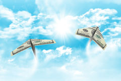 Paper airplanes made of hundred dollar bills Stock Photo