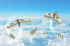 Paper airplanes made of hundred dollar bills Stock Image