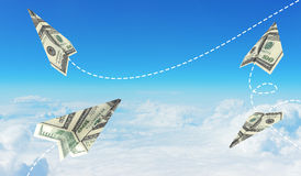 Paper airplanes made of hundred dollar bills Royalty Free Stock Photos