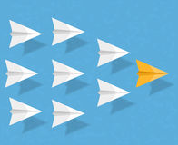 Paper Airplanes. Yellow paper airplane as a leader among white airplanes, leadership, teamwork, motivation, stand out of the crowd concept stock illustration