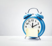 Paper and alarm clock Royalty Free Stock Photography