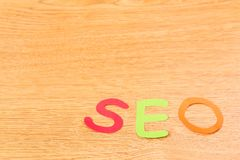 Alphabet SEO with Notebook and Pen Royalty Free Stock Photography