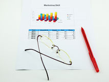 A paper of analyse marketing, pen and spectacles Royalty Free Stock Image