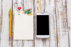 Paper And Smart Phone On White Wooden Table Stock Images