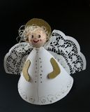 Paper angel 3. Angel made of white paper, black background Royalty Free Stock Photo