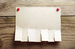 Paper for announcement. On a wooden background Stock Images