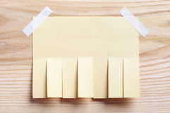 Paper for announcement. On a wooden background Royalty Free Stock Photo