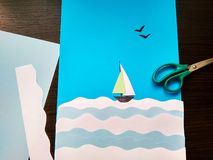 Paper application of a sailboat on the sea and seagulls stock photography
