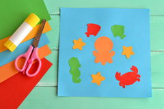 Paper applique with sea animals and fishes. Art lesson in kindergarten. Paper sea animals. Octopus, fish, starfish, seahorse, crab Royalty Free Stock Photo