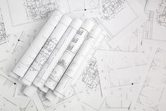 Paper architectural drawings and blueprint. Engineering blueprint and drawings. Engineer job stock photos