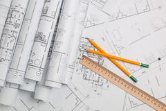 Paper architectural drawings, blueprint, ruler and pencil. Engineering blueprint. Paper architectural drawings, blueprint, ruler and a pencil. Engineering royalty free stock photo