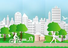 Paper art of people and pets with city and bicycle on green background, ecology idea.  Royalty Free Stock Photos
