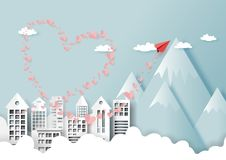 07. Love concept with cityscape. Paper art style of valentine`s day greeting card and love concept. Red paper airplane flying on urban city landscape with stock illustration