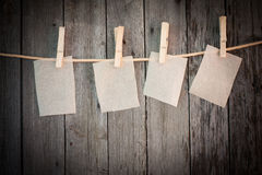Paper attach to rope with clothes pins Stock Photo