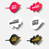 Paper autumn leaves.. Tags, icons, labels, stickers of red, white and black with text about discounts and prices are cut from paper with a shadow. Can be used Royalty Free Stock Photos