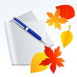 Paper and autumnal leaf Stock Photos