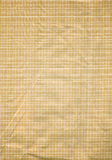 Paper background. Brown paper with nylon thread mesh inside Royalty Free Stock Photography
