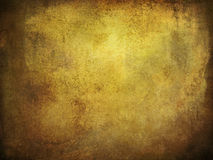 Paper background grunge. Old paper background with grungy structure and shifting brown colors Stock Photography