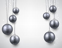 Paper background with silver christmas baubles. Stock Photography