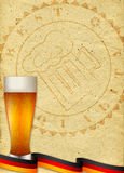 Paper background with stamp of quality and glass of beer Royalty Free Stock Image