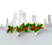 Paper background with town houses and holly Royalty Free Stock Photography
