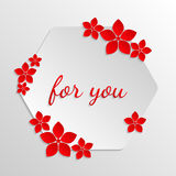 Paper badge with paper red flowers on grayscale background. For Stock Photography