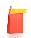 Paper bag. Red paper bag with yellow tag Royalty Free Stock Image