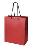 Paper-bag. Red beamless paper-bag with cords Stock Photo