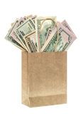 Paper bag with american dollars. shopping concept. Paper bag with american dollars isolated on white background. shopping concept stock image