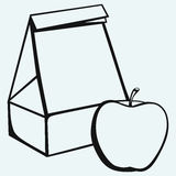 Paper bag and apple. Isolated on blue background Stock Photo